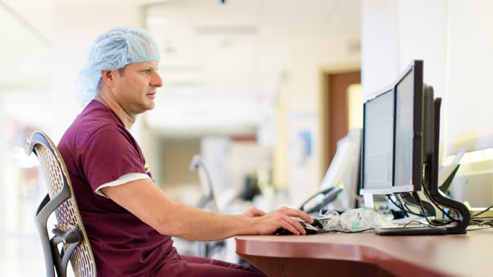 clinician looking at computer screen